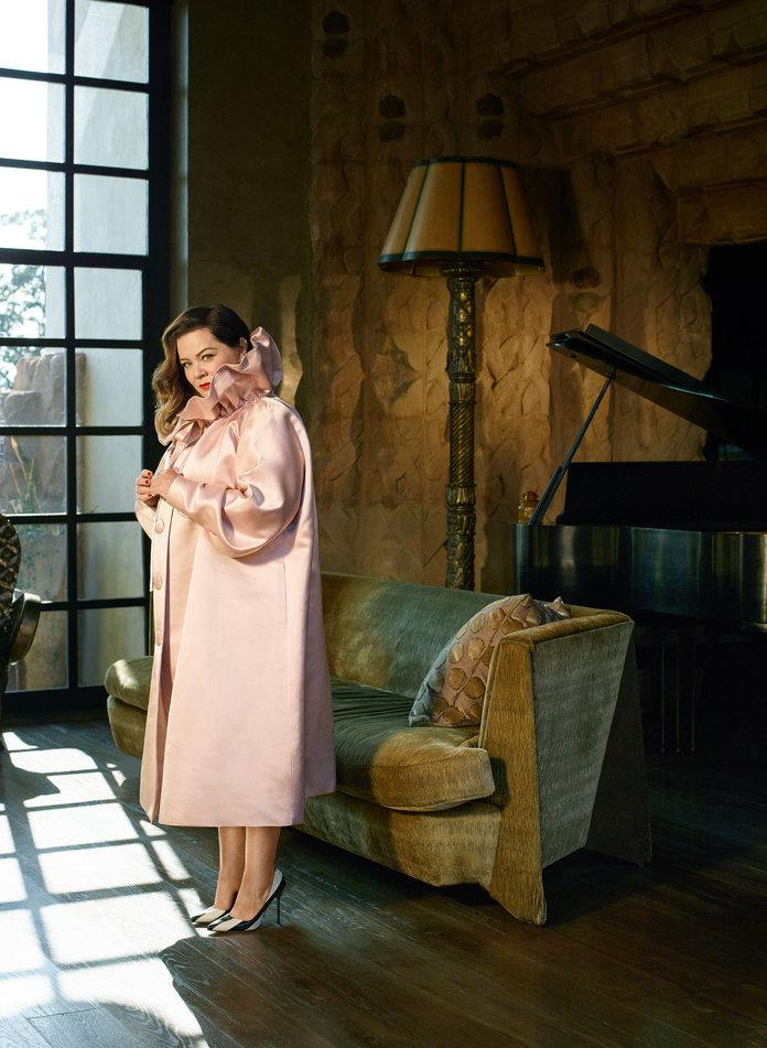 <p>McCarthy in a Marc Jacobs coat,&nbsp;Forevermark by Martin Flyer earrings, a&nbsp;Forevermark by Pluczenik ring (on right hand), a&nbsp;Chopard ring (on left hand), and&nbsp;Manolo Blahnik pumps. Photographed by Robbie Fimmano.</p>