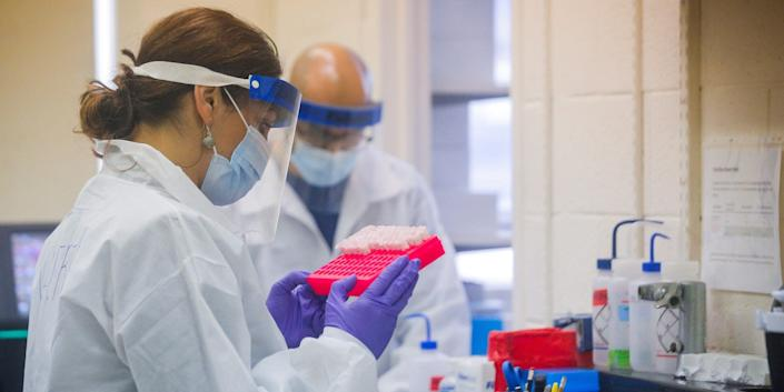Scientists work in a lab testing COVID-19 samples at New York City's health department, during the outbreak of the coronavirus disease (COVID-19) in New York City, New York U.S., April 23, 2020. Picture taken April 23, 2020. REUTERS/Brendan McDermid/