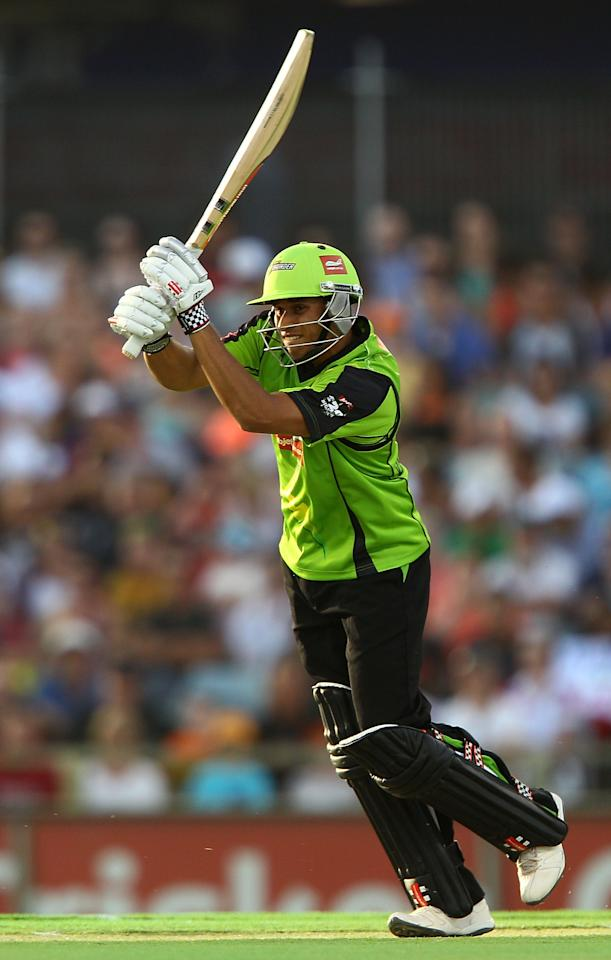 PERTH, AUSTRALIA - JANUARY 04:  Usman Khawaja of the Thunder hits out  during the Big Bash League match between the Perth Scorchers and the Sydney Thunder at WACA on January 4, 2013 in Perth, Australia.  (Photo by Paul Kane/Getty Images)