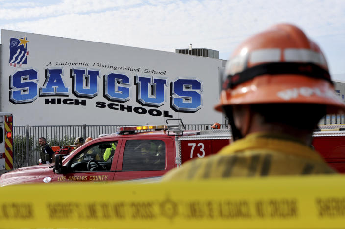 First responders standby for any injured students after a gunman opened fire at Saugus High School on Nov. 14, 2019, in Santa Clarita, Calif. (Photo: Christian Monterrosa/AP)