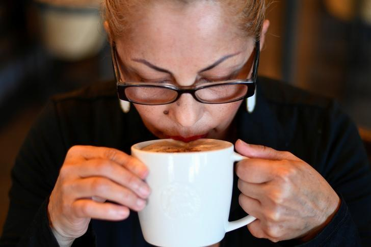 A customer sips on a coffee at a Starbucks coffeehouse in Austin, Texas, U.S.,