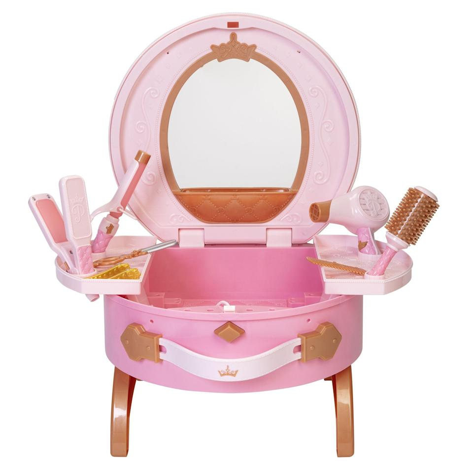 """<p><strong>Disney Princess</strong></p><p>walmart.com</p><p><strong>$46.95</strong></p><p><a href=""""https://go.redirectingat.com?id=74968X1596630&url=https%3A%2F%2Fwww.walmart.com%2Fip%2F287752772&sref=https%3A%2F%2Fwww.bestproducts.com%2Fparenting%2Fg34074265%2Fwalmart-top-toys-of-2020%2F"""" rel=""""nofollow noopener"""" target=""""_blank"""" data-ylk=""""slk:Shop Now"""" class=""""link rapid-noclick-resp"""">Shop Now</a></p><p>Your little one watches you primp and prep, and it's natural that they'll want to do it too. Interactive play is big this season — and this pretend vanity set, complete with hair tools and a mirror, fits that trend perfectly. </p>"""