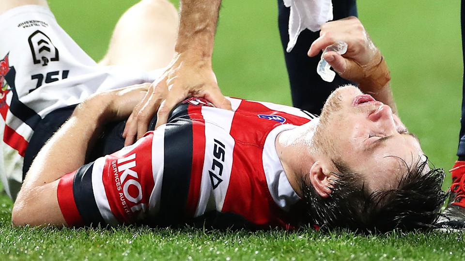 Luke Keary, pictured here going down injured in the Roosters' clash with the Storm.