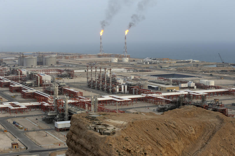 FILE - This March 16, 2019 file photo, shows natural gas refineries at the South Pars gas field on the northern coast of the Persian Gulf, in Asaluyeh, Iran. China's state oil company has pulled out of a $5 billion deal to develop a portion of Iran's massive offshore natural gas field, the Islamic Republic's oil minister said Sunday, Oct. 6, 2019, an agreement from which France's Total SA earlier withdrew over U.S. sanctions. (AP Photo/Vahid Salemi, File)