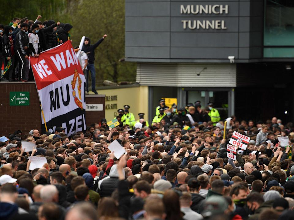 Thousands of United fans gathered outside Old Trafford, with hundreds taking to the pitchAFP via Getty Images