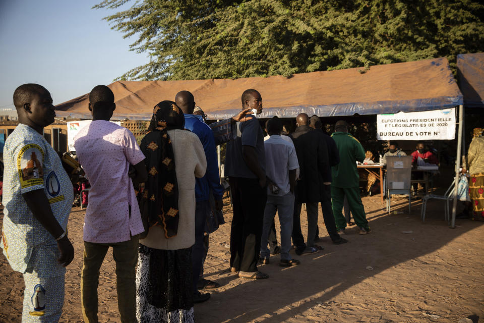 People line up to vote in Burkina Faso's presidential and legislative elections in Ouagadougou Sunday Nov. 22, 2020. Voters went to the polls in Burkina Faso on Sunday for the elections that have been marred by ongoing extremist violence in this landlocked West African nation. (AP Photo/Sophie Garcia)