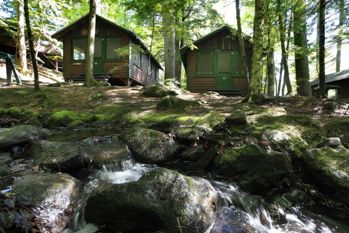 In this Thursday, June 4, 2020 photo, cabins awaits campers at the Camp Winnebago summer camp in Fayette, Maine. (Robert F. Bukaty/AP Photo)