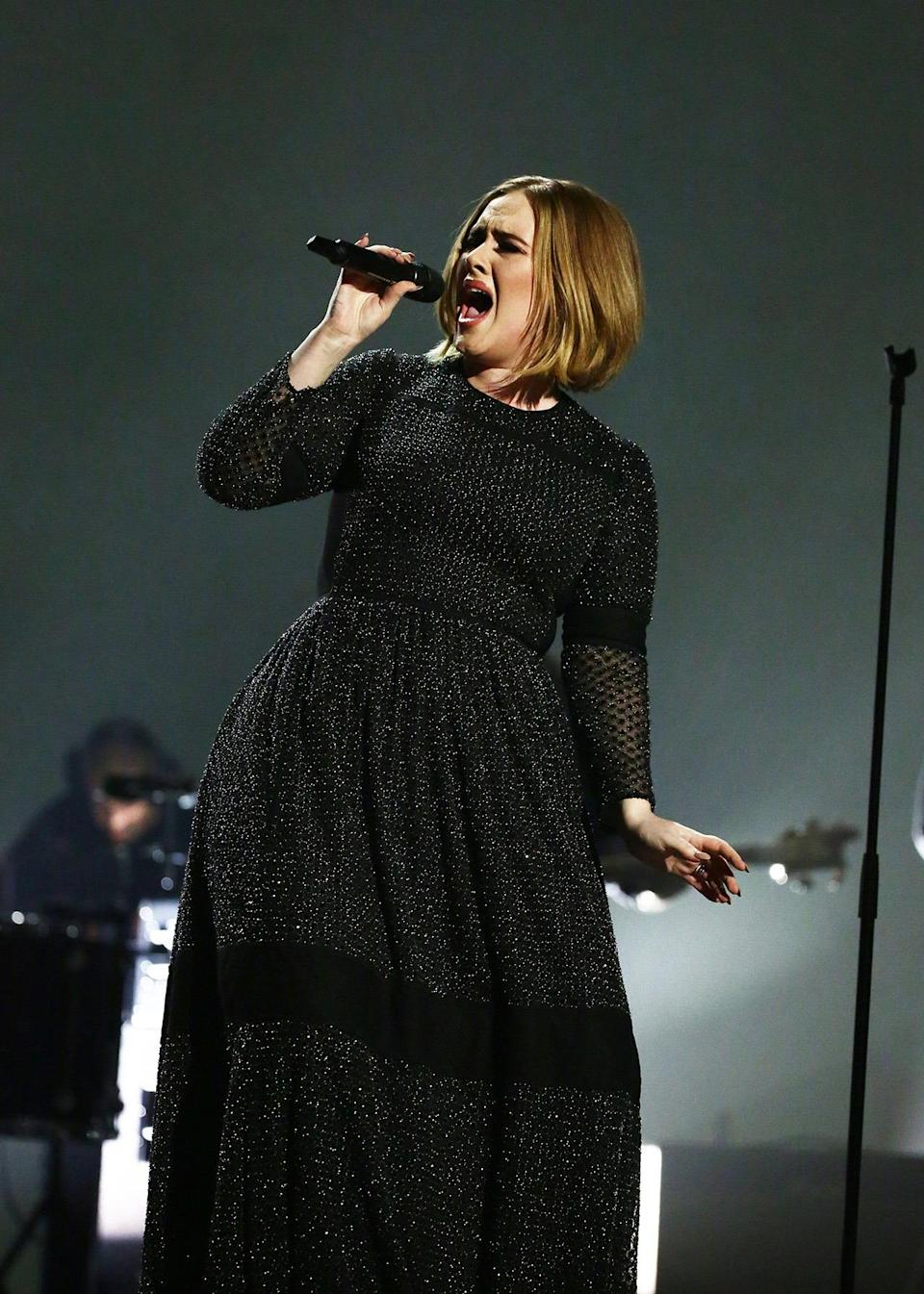 <p>Adele might be catching flack for her pre-recorded performance on the <i>X-Factor</i> finale, but there hasn't been any backlash in response to her beautiful look. Not only did she look stunning in a custom black Burberry gown covered in shimmery embellishments, but she also debuted a major new haircut. <i>Photo: Corbis</i></p>