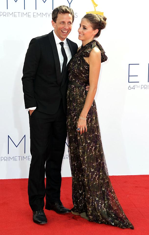 Seth Meyers and Alexi Ashe arrive at the 64th Primetime Emmy Awards at the Nokia Theatre in Los Angeles on September 23, 2012.
