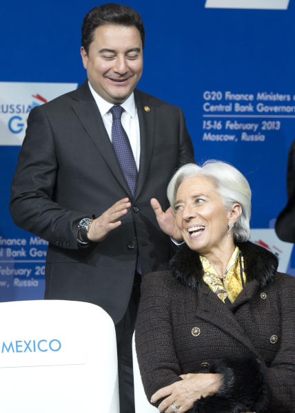 Chief of the International Monetary Fund Christine Lagarde prepares for a group photo at a meeting of G20 Finance Ministers and Central Bank Governors in Moscow, Russia, Saturday, Feb. 16, 2013. (AP Photo/Misha Japaridze)