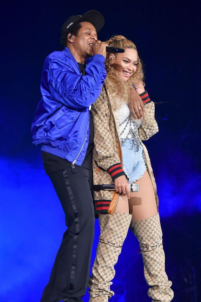 <p>Jay-Z and a Gucci-clad Beyoncé performing during On The Road II in Cardiff.</p>