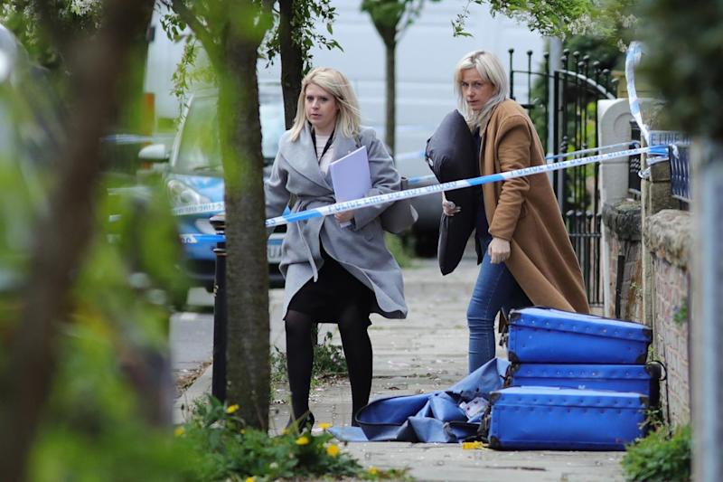 Crime scene: The wife of the former officer was joined by family members (Christopher Furlong/Getty Images)