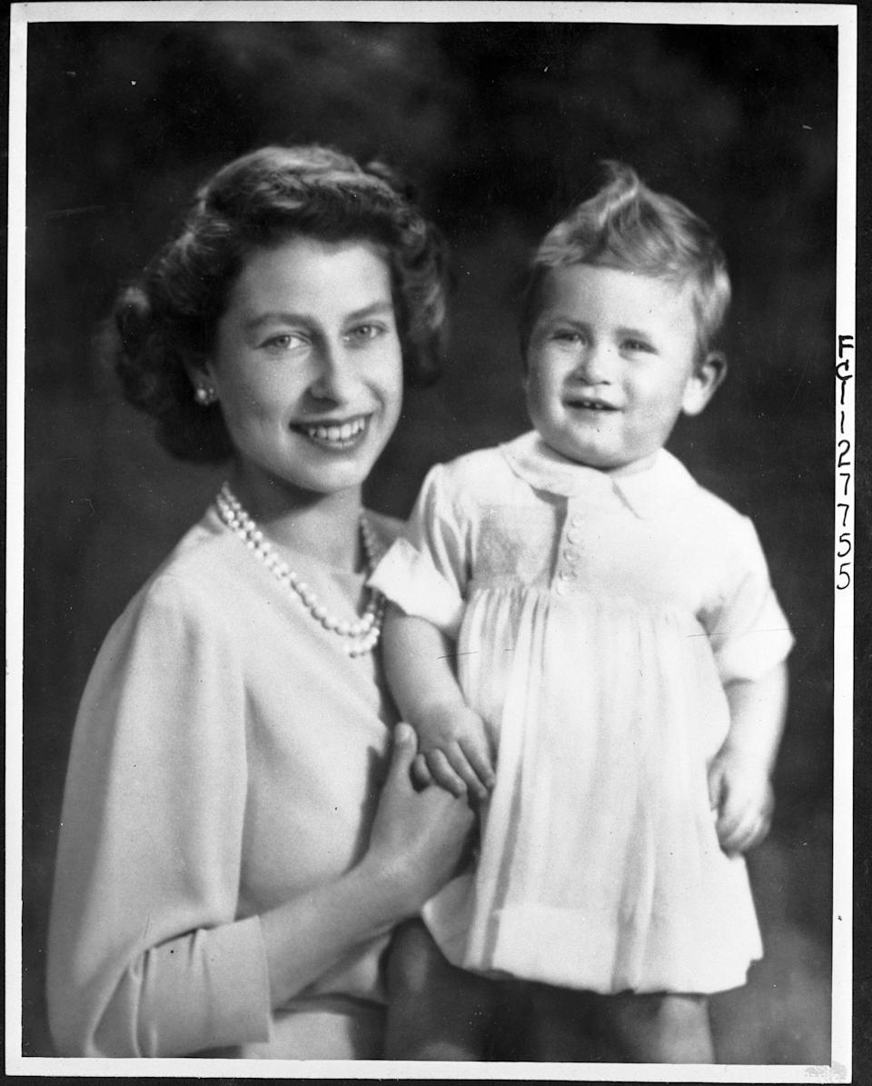 Then-Princess Elizabeth and Charles, on the eve of his first birthday.