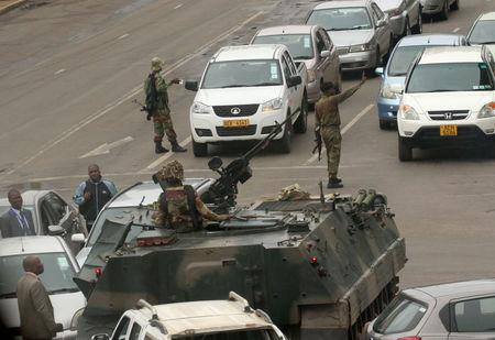 Military vehicles and soldiers patrol the streets in Harare.    REUTERS/Philimon Bulawayo
