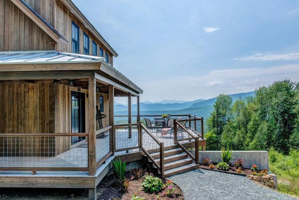 """<p>The view from this secluded three-bedroom home is a watercolorist's dream: layers upon layers of hazy blue and gray mountains. Part of the northern Appalachians, the White Mountains are some of the most rugged in New England. The property itself, which is 11 miles from <a href=""""https://www.nhstateparks.org/visit/state-parks/mt-washington-state-park"""" rel=""""nofollow noopener"""" target=""""_blank"""" data-ylk=""""slk:Mount Washington State Park"""" class=""""link rapid-noclick-resp"""">Mount Washington State Park</a>, was designed to complement these environs: The solar-powered cabin is both LEED- and NAHB-certified. Luxury touches abound, too, including a wet bar, billiards table, and chef's kitchen done up in marble and soapstone. </p> <p><strong>Book now:</strong> <a href=""""https://airbnb.pvxt.net/2xMkz"""" rel=""""nofollow noopener"""" target=""""_blank"""" data-ylk=""""slk:From $350 per night, airbnb.com"""" class=""""link rapid-noclick-resp"""">From $350 per night, airbnb.com</a></p>"""