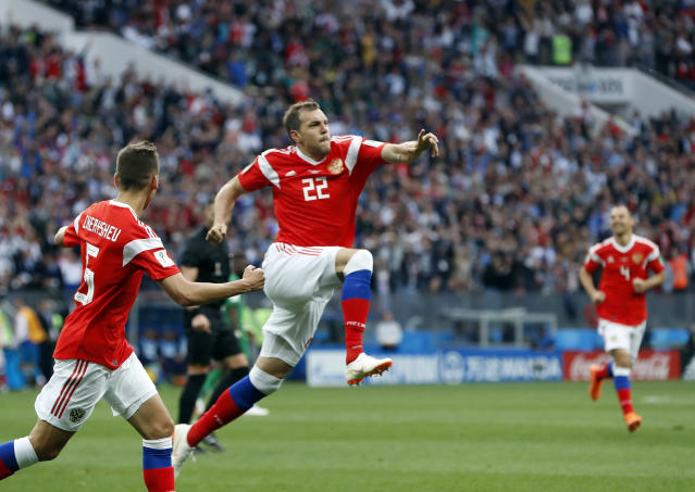 <p>Russia's Artyom Dzyuba, center, celebrates after scoring his side's third goal during the group A match between Russia and Saudi Arabia which opens the 2018 soccer World Cup at the Luzhniki stadium in Moscow, Russia, Thursday, June 14, 2018. (AP Photo/Pavel Golovkin) </p>