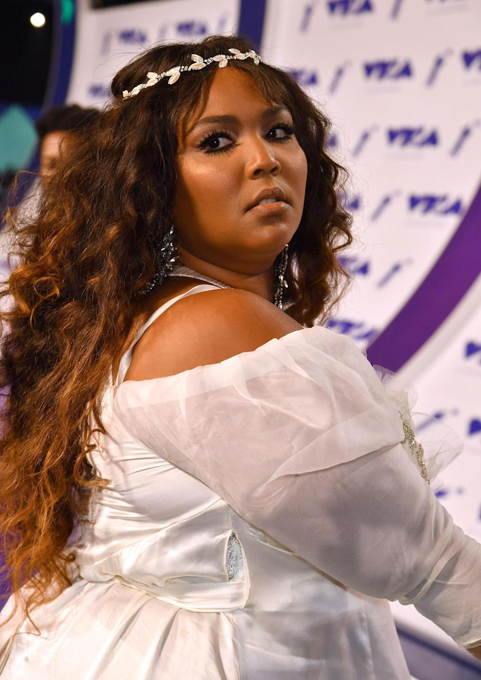 We've always known that Lizzo was rap royalty, but this VMAs look just proved it.