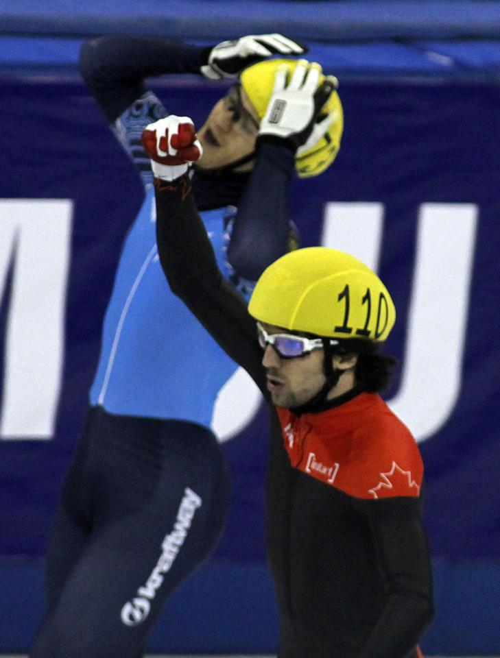 SHANGHAI, CHINA - DECEMBER 09:  Charles Hamelin (R) of Canada celebrates as he defeats Vladimir Grigorev of Russia in the Men's 500m Final during the day two of the ISU World Cup Short Track at the Oriental Sports Center on December 9, 2012 in Shanghai, China.  (Photo by Hong Wu/Getty Images)