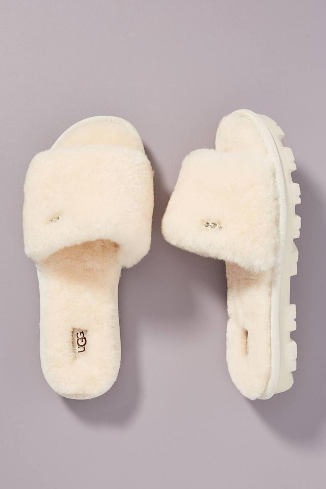 """<p><strong>UGG </strong></p><p>anthropologie.com</p><p><strong>$80.00</strong></p><p><a href=""""https://go.redirectingat.com?id=74968X1596630&url=https%3A%2F%2Fwww.anthropologie.com%2Fshop%2Fugg-cozette-slippers2&sref=https%3A%2F%2Fwww.cosmopolitan.com%2Fstyle-beauty%2Ffashion%2Fg31925662%2Fbest-womens-slippers%2F"""" target=""""_blank"""">Shop Now</a></p><p>These slip-on Uggs are gonna keep your toes so warm; plus, the rubber soles will prevent you from sliding around.</p>"""