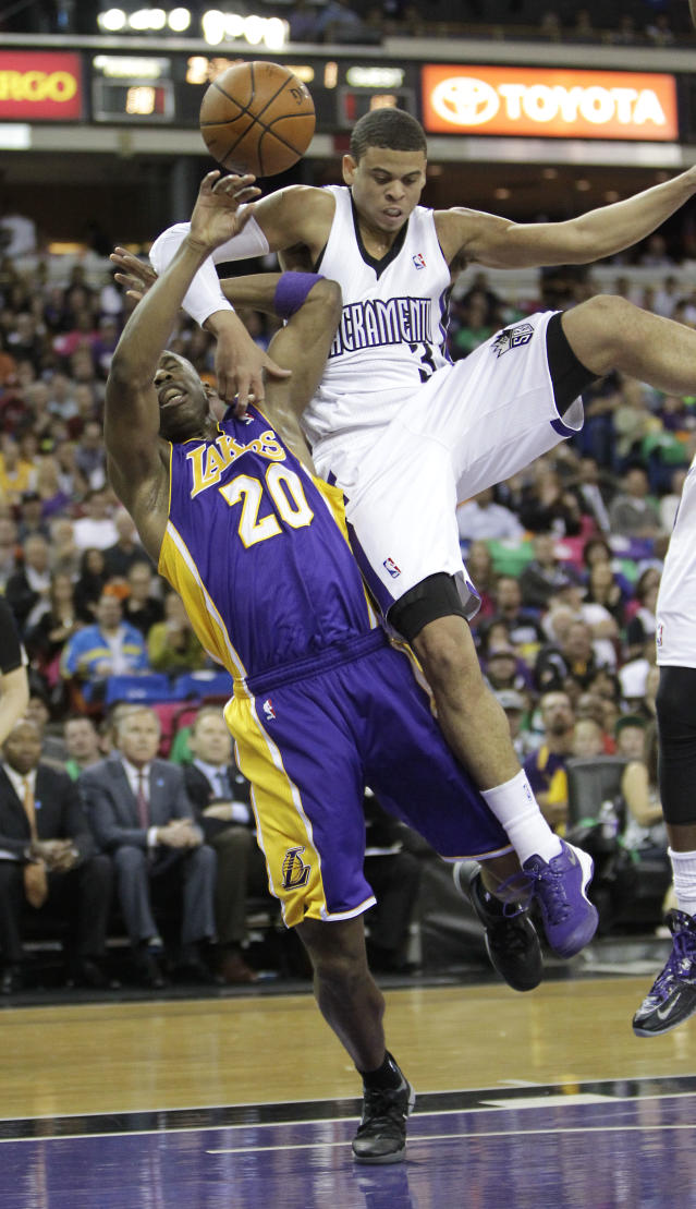 Los Angeles Lakers guard Jodie Meeks, left, is fouled by Sacramento Kings guard Ray McCallum during the first quarter of an NBA basketball game Wednesday, April 2, 2014, in Sacramento, Calif. (AP Photo/Rich Pedroncelli)