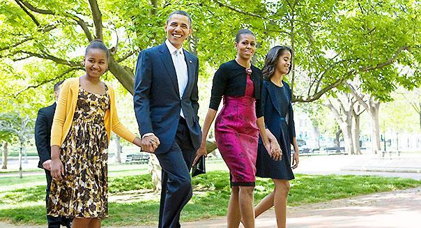 8 April 2012 - Washington, D.C. - President Barack Obama, First Lady Michelle Obama and daughters Sasha and Malia Obama walk across Lafayette Park to St. John's Episcopal Church to attend easter services. Photo Credit: Kristoffer Tripplaar/ Sipa Press
