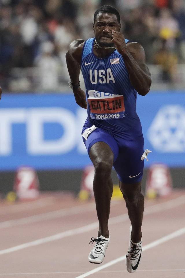 FILE - In this Sept. 28, 2019, file photo, Justin Gatlin, of the United States, competes enroute to a silver medal in the 100m event at the World Athletics Championships in Doha, Qatar. Gatlin will be 39 by the time the games roll around, and Jamaican Asafa Powell is just nine months younger. They are both ancient in this young sprinter's game. They still think they can give the younger generation a run for their money. (AP Photo/Petr David Josek, File)