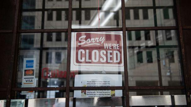 PHOTO: A 'closed' sign hangs on the door of Lafayette Coney Island restaurant in Detroit, Michigan, April 4, 2020. (Emily Elconin/Bloomberg via Getty Images)