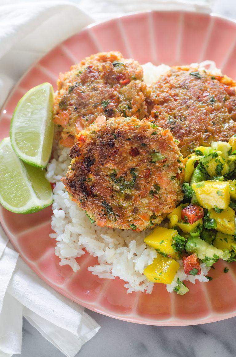 """<p>Even salmon skeptics will love these pan-fried cakes, which get a satisfying crunch from panko breadcrumbs, green onions, and bell pepper. Serve them with fresh mango salsa and buttery white rice. </p><p><strong>Get the recipe from <a href=""""https://www.thepioneerwoman.com/food-cooking/recipes/a102451/salmon-cakes-with-mango-salsa/"""" rel=""""nofollow noopener"""" target=""""_blank"""" data-ylk=""""slk:Erica Kastner"""" class=""""link rapid-noclick-resp"""">Erica Kastner</a>.</strong> </p>"""