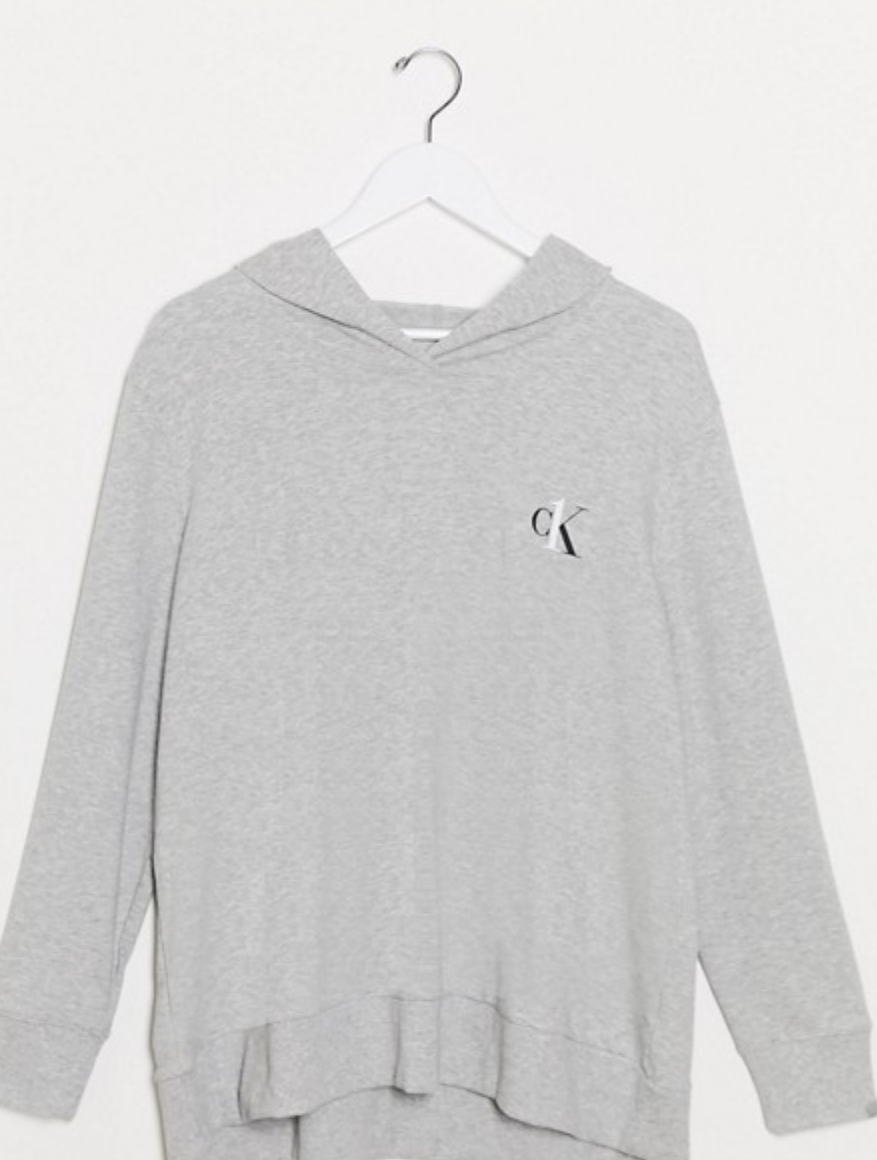 "Calvin Klein makes some of the comfiest loungewear—and this hoodie proves it. It's made of the softest jersey cotton and is the perfect match for your favorite pair of <a href=""https://www.glamour.com/gallery/best-black-leggings-to-buy-now?mbid=synd_yahoo_rss"" rel=""nofollow noopener"" target=""_blank"" data-ylk=""slk:black leggings"" class=""link rapid-noclick-resp"">black leggings</a>. $58, Asos. <a href=""https://www.asos.com/us/calvin-klein/calvin-klein-plus-size-ck-one-basic-lounge-hoodie-in-gray/prd/14553096"" rel=""nofollow noopener"" target=""_blank"" data-ylk=""slk:Get it now!"" class=""link rapid-noclick-resp"">Get it now!</a>"
