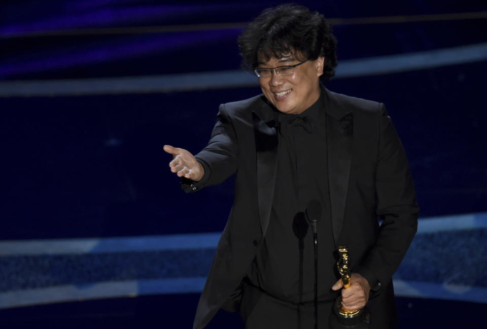"""Bong Joon Ho accepts the award for best director for """"Parasite"""" at the Oscars on Sunday, Feb. 9, 2020, at the Dolby Theatre in Los Angeles. (AP Photo/Chris Pizzello)"""