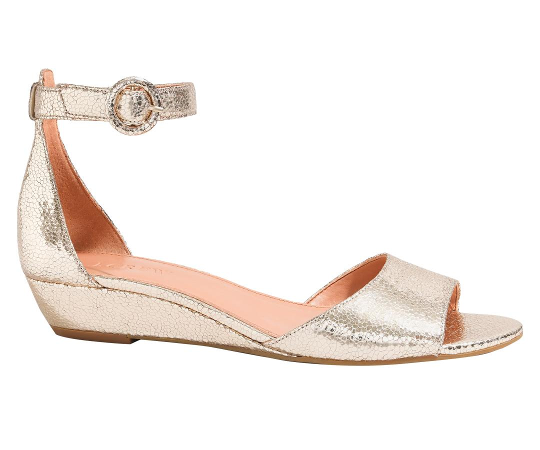 """<p>Oh the outdoor summer wedding! So chic! So romantic! So...difficult to pick out shoes for. Opt for a natural colored pair of wedges that can be work in the sand and the street. Extra points if they're metallic.</p> <p>$59 