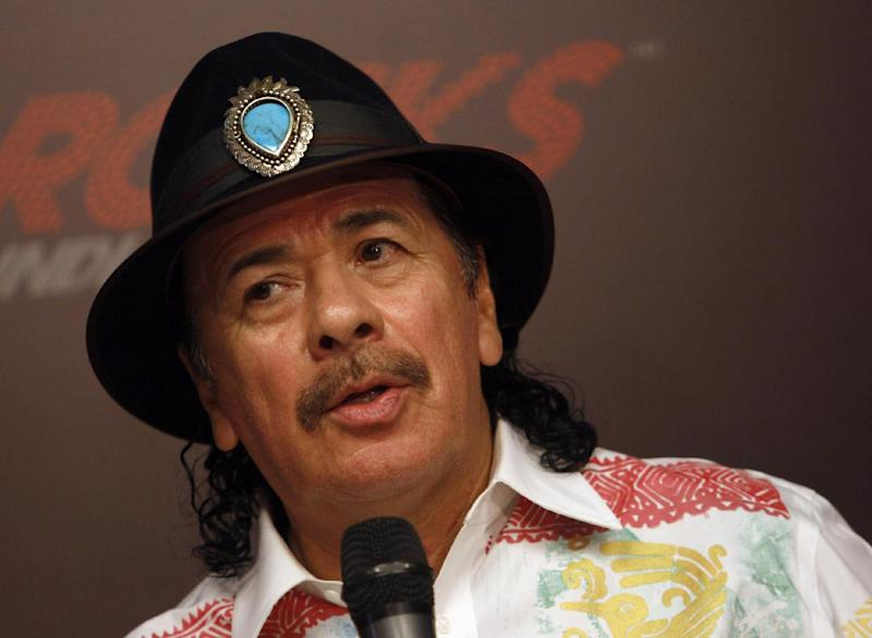 FILE - In this Oct. 27, 2012 file photo, musician Carlos Santana speaks during a news conference in New Delhi, India. Santana, Billy Joel, jazz artist Herbie Hancock and opera star Martina Arroyo, are the four musicians who will receive this year's Kennedy Center Honors, along with actress Shirley MacLaine. The Kennedy Center for the Performing Arts announced the selections Thursday. The honorees also include . (AP Photo/Tsering Topgyal, File)