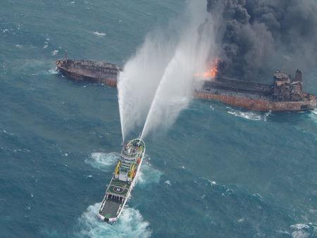 A rescue ship works to extinguish the fire on the stricken Iranian oil tanker Sanchi in the East China Sea, on January 10, 2018 in this photo provided by Japan's 10th Regional Coast Guard. Picture taken on January 10, 2018.  10th Regional Coast Guard Headquarters/Handout via REUTERS