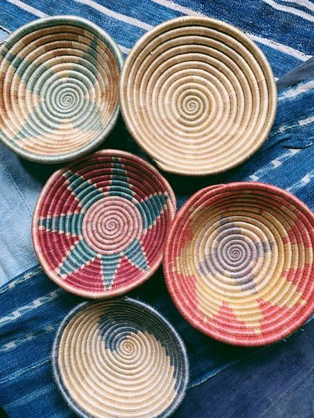 "<p><strong>BLK MKT Vintage</strong></p><p>blkmktvintage.com</p><p><strong>$22.00</strong></p><p><a href=""https://www.blkmktvintage.com/products/vintage-woven-multicolor-patterned-bowl-basket-uganda-2"" rel=""nofollow noopener"" target=""_blank"" data-ylk=""slk:Shop Now"" class=""link rapid-noclick-resp"">Shop Now</a></p><p>Vintage red- and blue-tinted baskets bring marketplace charm to any living space. </p>"