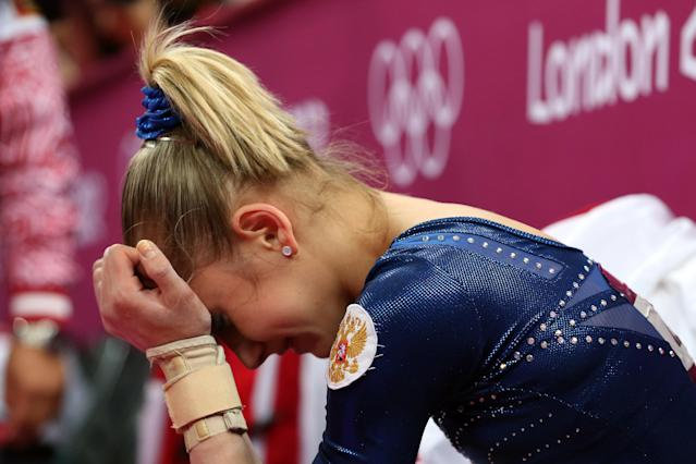 LONDON, ENGLAND - AUGUST 02: Victoria Komova of Russia reacts after finishing in second and winning the silver medal in the Artistic Gymnastics Women's Individual All-Around final on Day 6 of the London 2012 Olympic Games at North Greenwich Arena on August 2, 2012 in London, England. (Photo by Ronald Martinez/Getty Images)
