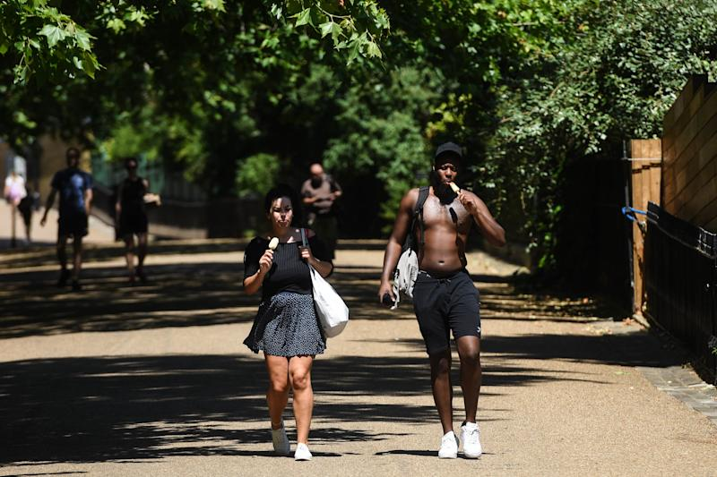 LONDON, ENGLAND - JUNE 25: People are seen eating ice creams on June 25, 2020 in London, United Kingdom. The UK is experiencing a summer heatwave, with temperatures in many parts of the country expected to rise above 30C and weather warnings in place for thunderstorms at the end of the week. (Photo by Peter Summers/Getty Images)