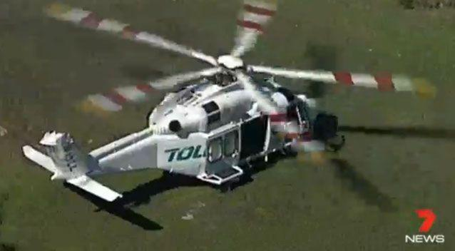 A crew had a helicopter ready to transport the man from the beach. Source: 7 News