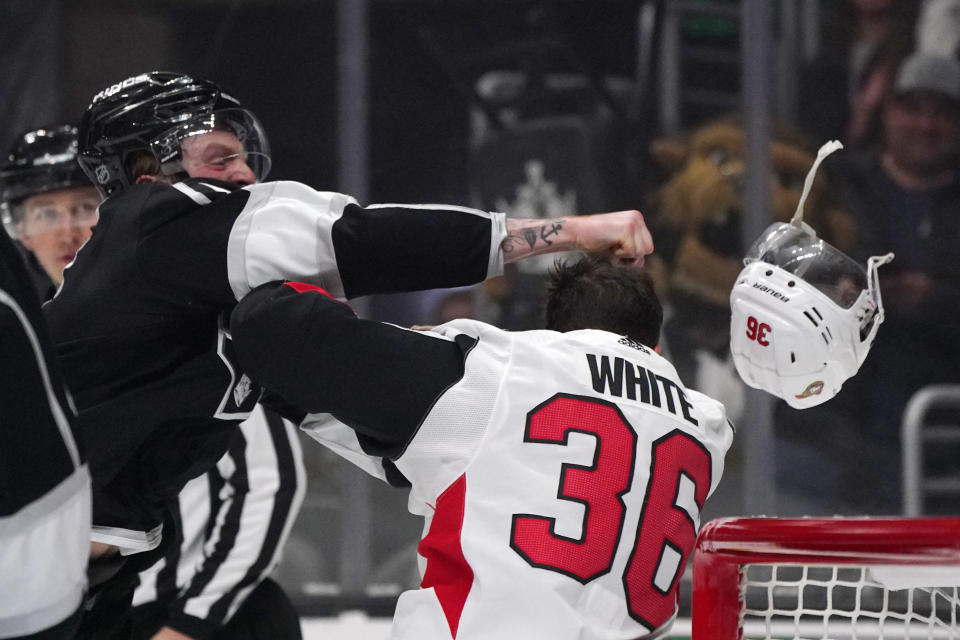 Los Angeles Kings left wing Austin Wagner, left, and Ottawa Senators center Colin White fight during the first period of an NHL hockey game Wednesday, March 11, 2020, in Los Angeles. (AP Photo/Mark J. Terrill)
