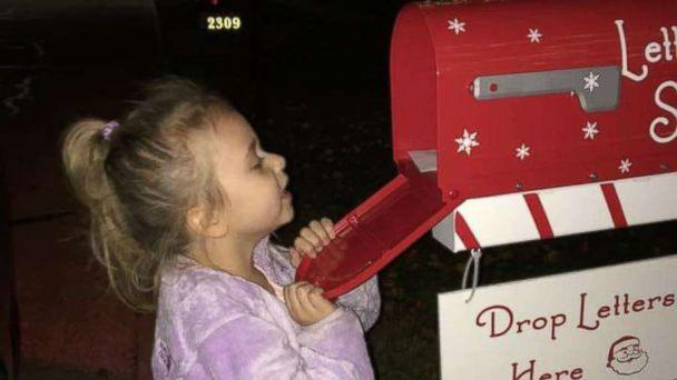 PHOTO: Dylann Dutton peeks inside the magical Letters to Santa mailbox. (Shawna Calvert/Letters to Santa Mail Station)