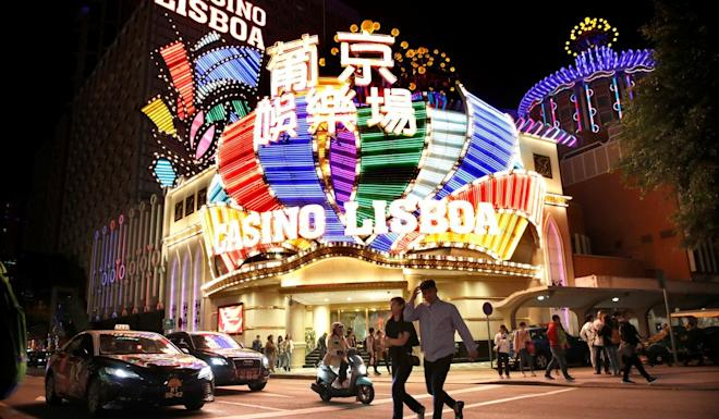 People walk in front of Casino Lisboa in Macau in December 2019. Photo: Reuters