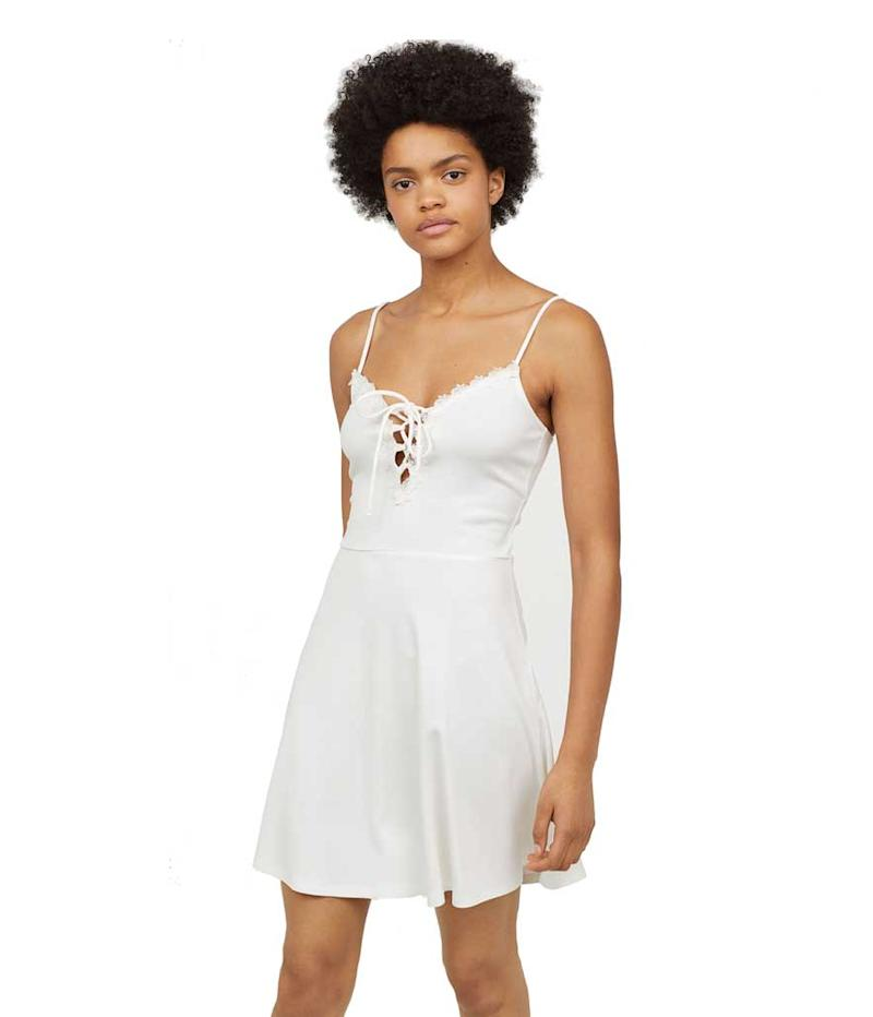 White lace-up dress with lace detail. (Photo: H&M)