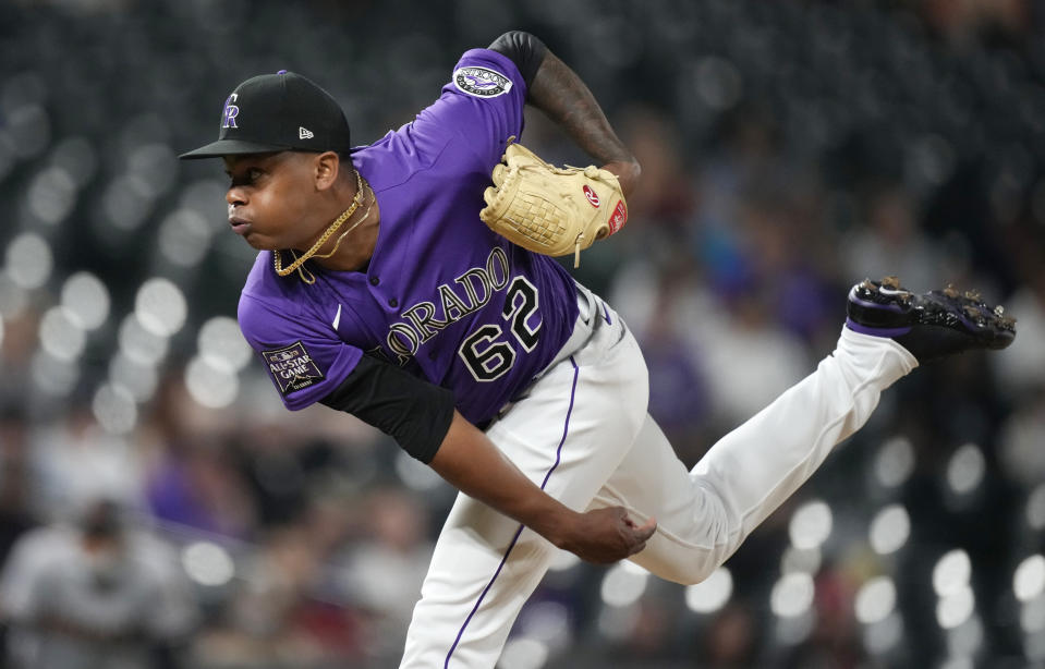 Colorado Rockies relief pitcher Yency Almonte works against the Arizona Diamondbacks in the ninth inning of a baseball game Friday, May 21, 2021, in Denver. (AP Photo/David Zalubowski)