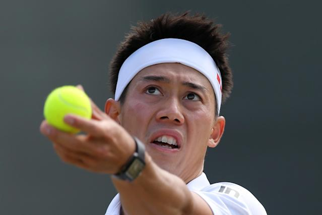 Japan's Kei Nishikori serves during his men's singles fourth round match against Canada's Milos Raonic on day eight of the 2014 Wimbledon Championships in Wimbledon, southwest London, on July 1, 2014 (AFP Photo/Andrew Cowie)
