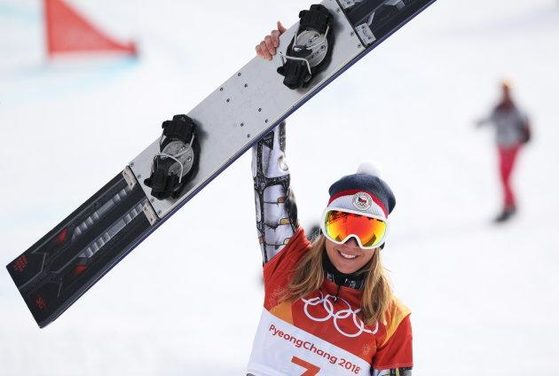 The Czech Republic's Ester Ledecka celebrates as she wins gold in the ladies' snowboard parallel giant slalom.