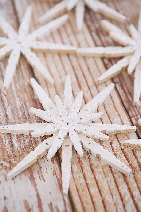 """<p>These versatile, glittering snowflakes are so easy to make—and thank goodness because you'll want to display them everywhere! Craft a batch of these to hang from your Christmas tree, display on your mantel, attach to gifts, or showcase just about anywhere.</p><p><strong>Get the tutorial at <a href=""""https://eighteen25.com/2014/11/glittered-clothespin-snowflakes/"""" rel=""""nofollow noopener"""" target=""""_blank"""" data-ylk=""""slk:Eighteen25"""" class=""""link rapid-noclick-resp"""">Eighteen25</a>.</strong></p><p><strong><a class=""""link rapid-noclick-resp"""" href=""""https://www.amazon.com/Whitmor-Natural-Wood-Clothespins-100/dp/B002HRLL2U/?tag=syn-yahoo-20&ascsubtag=%5Bartid%7C10050.g.23489557%5Bsrc%7Cyahoo-us"""" rel=""""nofollow noopener"""" target=""""_blank"""" data-ylk=""""slk:SHOP CLOTHESPINS"""">SHOP CLOTHESPINS</a><br></strong></p>"""