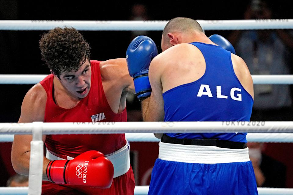 Richard Torrez Jr., left, takes on Chouaib Bouloudinats of Algeria in a match at the Tokyo Olympics.