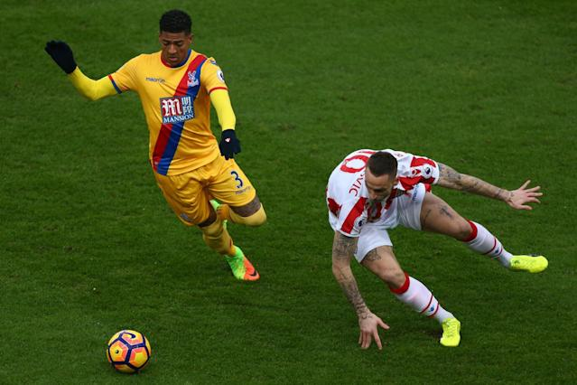 <p>Stoke City's Marko Arnautovic (right) and Crystal Palace's Patrick van Aanholt battle for the ball</p>