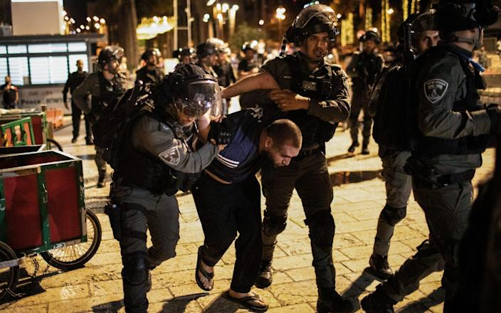 Israeli security forces arrest a man during a demonstration against the planned eviction process for the Palestinians in the Sheikh Jarrah neighbourhood - Avalon/Avalon
