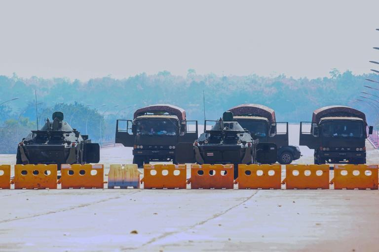 Military vehicles on a blockaded road near Myanmar's parliament in Naypyidaw on February 4, 2021