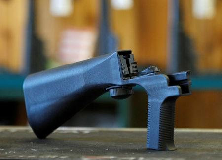 FILE PHOTO: An example of a bump stock that attaches to a semi-automatic rifle to increase the firing rate is seen at Good Guys Gun Shop in Orem, Utah, U.S. on October 4, 2017. REUTERS/George Frey/File Photo